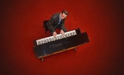Afbeelding › Pianist Nol van Beek